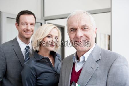 3 business people looking at camera