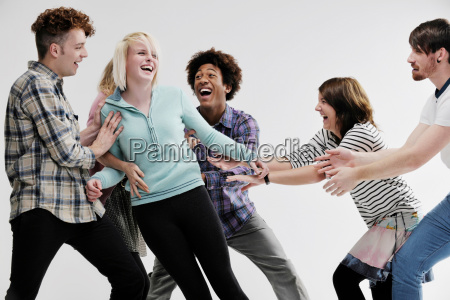 group of young adults pushing each