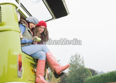 women sharing hot drink
