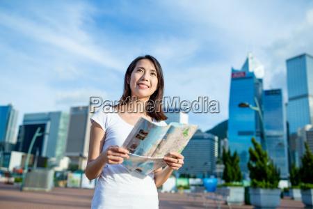 woman using city guide in hong
