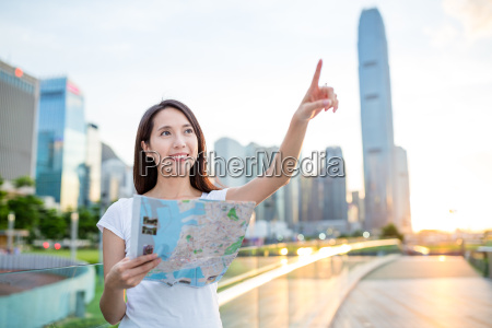 woman using city map