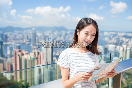 woman looking at the city map