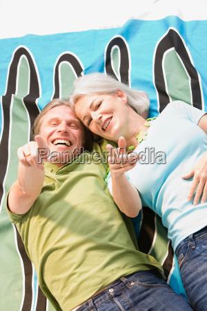 couple laying on blanket