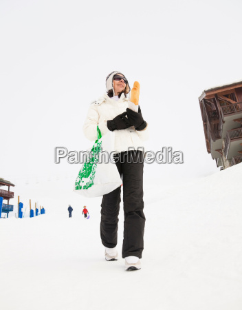 woman with bread walking in snow