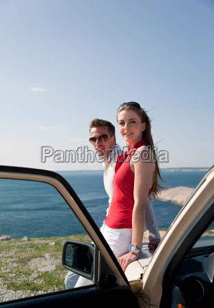 couple with oldtimer by sea