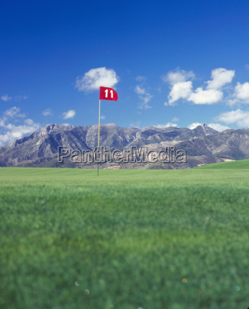golf tee spain with mountain background