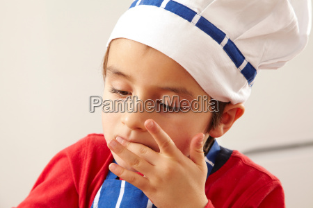 close up of young boy licking