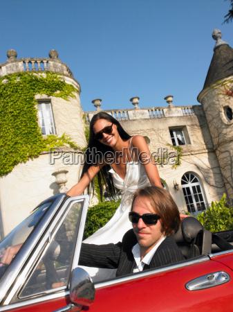 freshly married couple in car