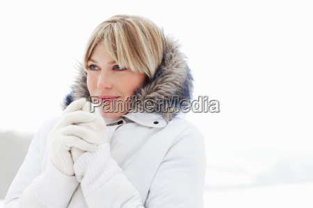 young woman in fluffy hood in