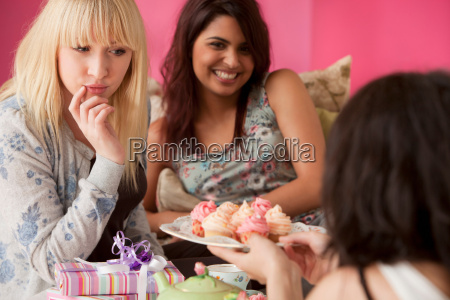 three young women having a tea