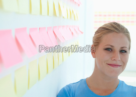 happy woman with sticky notes