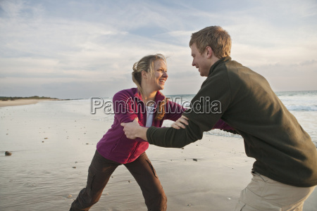 young man and woman wrestling at