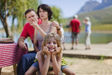 young girl smiling at picnic bench