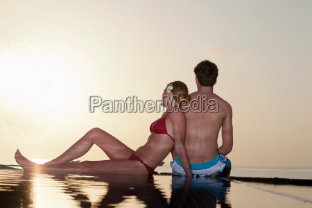 couple sitting at edge of infinity
