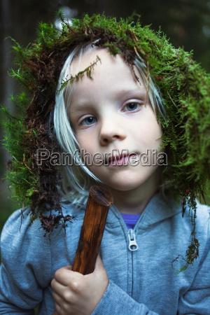 girl wearing moss on her head
