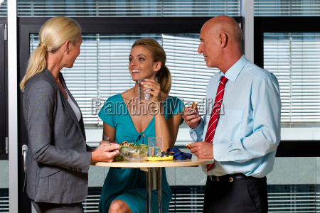 business people eating lunch in office