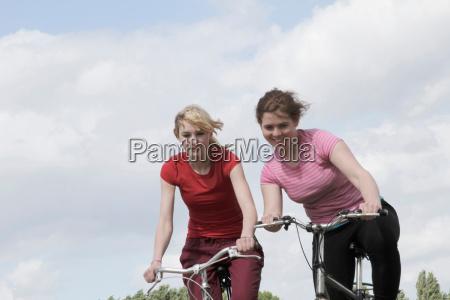 girls riding bikes outdoors