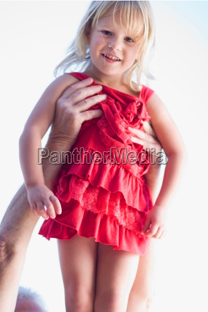 man holding young girl in the