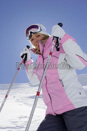 skier holding poles on mountainside