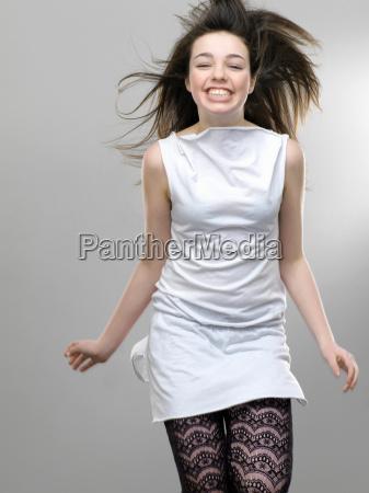 smiling girl jumping for joy