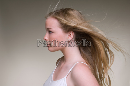teenage girls hair blowing in wind