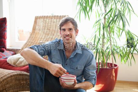 man relaxing in living room