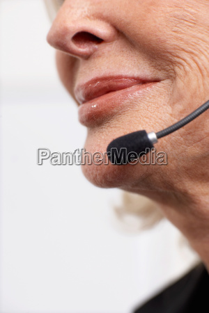 woman smiling on headset
