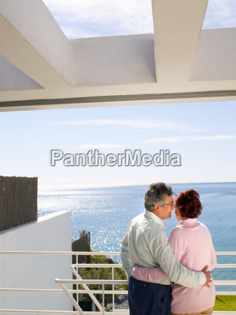 mature couple looking out to sea