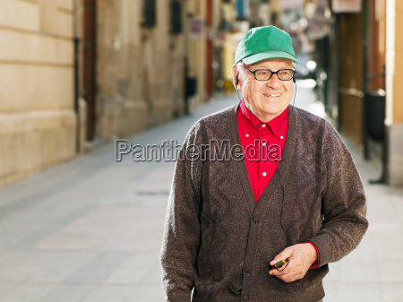 senior adult man standing in street