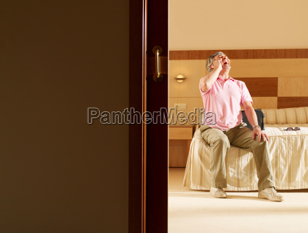 senior adult man sitting on hotel