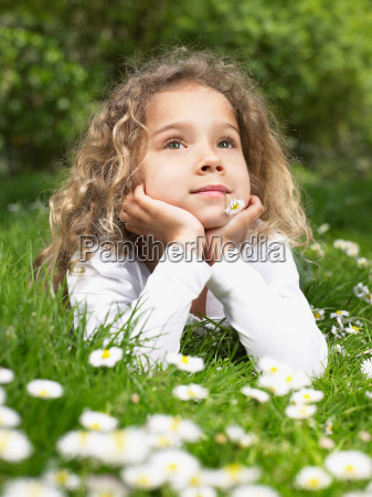 young girl with flower in mouth