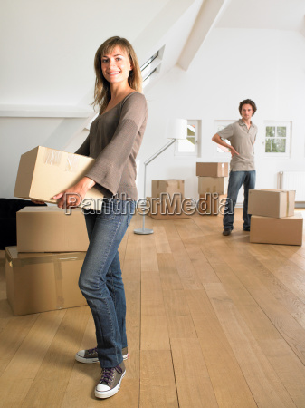 couple moving into new home smiling
