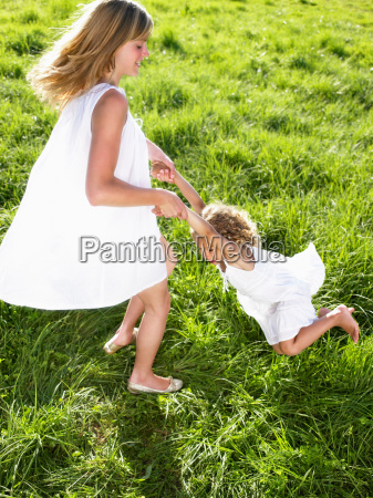 young woman and little girl playing