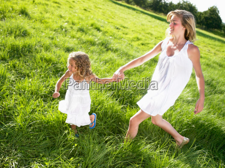 little girl and young woman walking