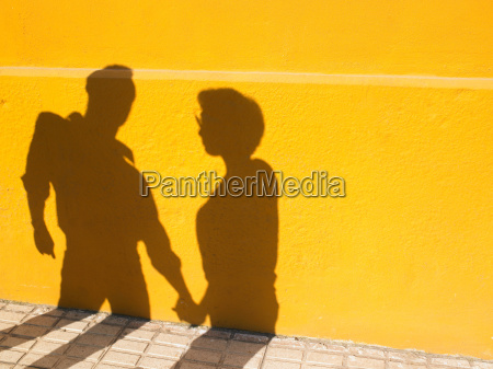 shadows of a couple holding hands