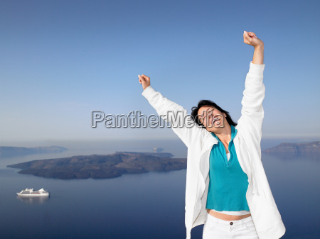 woman stretching her arms sea view