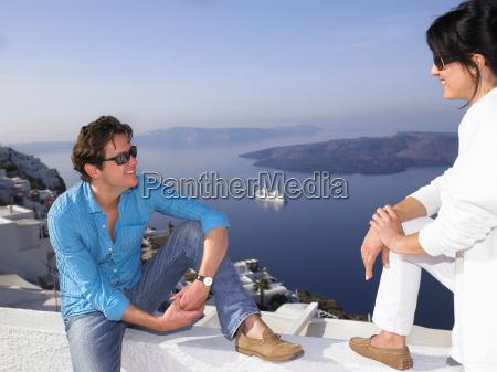 couple talking sea view