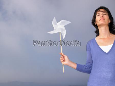 woman holding a windmill