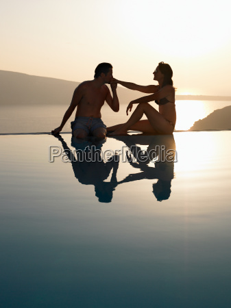 couple sitting on the edge of