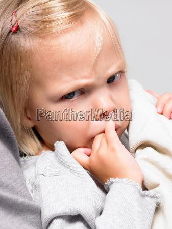 little girl making a face