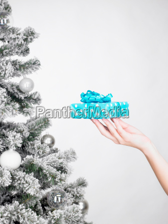 womans hand carrying a present