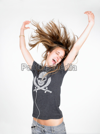 woman dancing and listening to music