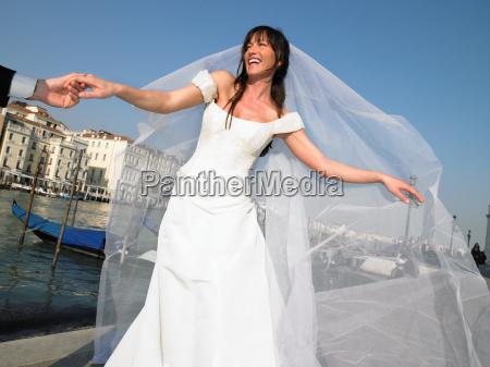 bride holding mans hand venice