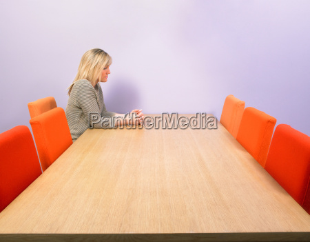 pensive businesswoman at meeting table