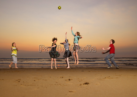 five teenagers playing catch