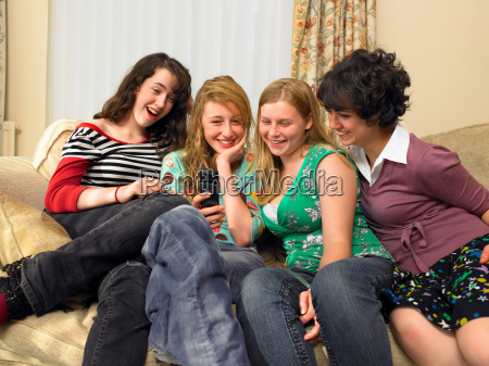 women looking at mobile phone