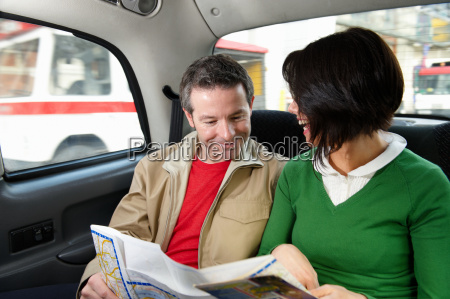 couple reading map in london taxi