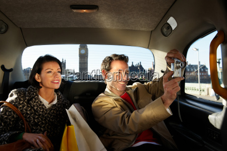 couple in london taxi big ben