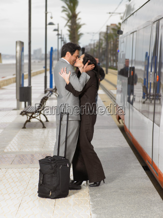 couple wearing business suits kissing