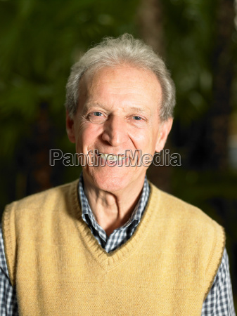 senior adult man in front of